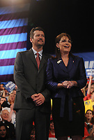 Sarah Palin, with husband Todd, addresses supporters at the Road to Victory Rally at the Riverfront Sports Complex in Scranton, Pennsylvania. October 14, 2008<br /> CAP/MPI01<br /> ©MPI01/Capital Pictures