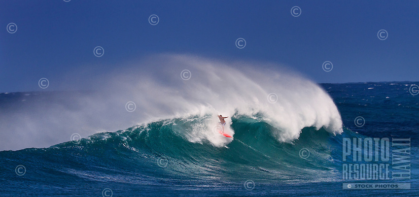Surfer riding large winter wave at Sunset Beach on the North Shore of O'ahu.