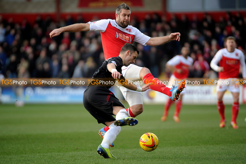 Jon Parkin of Fleetwood Town vies for the ball with Leon McSweeney of Northampton Town - Fleetwood Town vs Northampton Town - Sky Bet League Twol Football at Highbury Stadium, Fleetwood, Lancashire - 15/02/14 - MANDATORY CREDIT: Greig Bertram/TGSPHOTO - Self billing applies where appropriate - 0845 094 6026 - contact@tgsphoto.co.uk - NO UNPAID USE