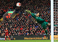 24th February 2020; Anfield, Liverpool, Merseyside, England; English Premier League Football, Liverpool versus West Ham United; West Ham United goalkeeper Lukasz Fabianski dives to save a shot from Sadio Mane of Liverpool