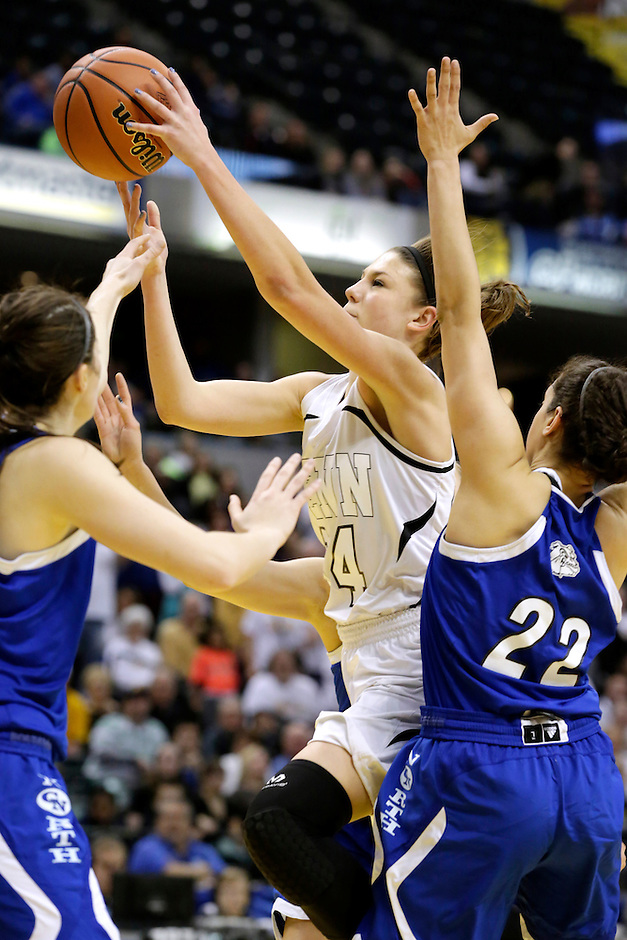 Penn's Camryn Buhr (34) puts up a shot in the paint during the IHSAA Class 4A Girls Basketball State Championship Game on Saturday, Feb. 27, 2016, at Bankers Life Fieldhouse in Indianapolis.