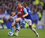 Wilfred Bouma of Aston Villa shields the ball from Manuel Fernandes of Everton during the Premier League match at Goodison Park  Stadium, Liverpool. Picture date 27th April 2008. Picture credit should read: Simon Bellis/Sportimage