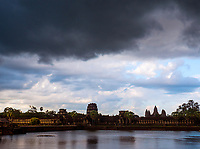 A dramatic black storm cloud over Angkor Wat, a World Heritage Site in Cambodia and the ever changing Weather during the Monsoon Season.