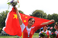 China's rowers Women's Quadruple Sculls on the podium celebrate after winning the Final event of the World Rowing Championships in Amsterdam, Netherlands, Saturday Aug. 30, 2014. - Photo by Paulo Amorim