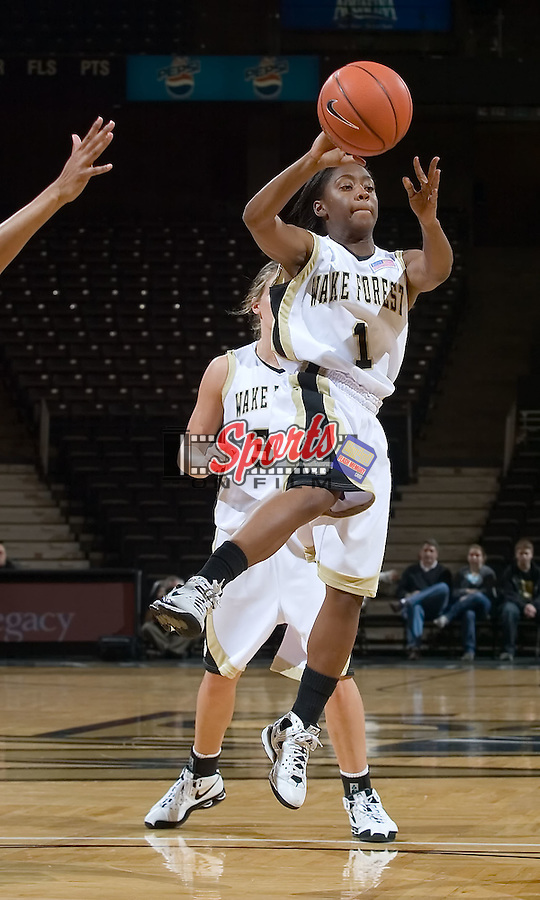 Brooke Thomas #1 of the Wake Forest Demon Deacons passes the ball as she drives the lane versus the East Tennessee State Buccaneers at the LJVM Coliseum December 28, 2008 in Winston-Salem, NC.  The Demon Deacons defeated the Buccaneers 72-66. (Photo by Brian Westerholt / Sports On Film)