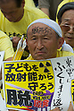 September 19, 2011, Harajuku, Tokyo, Japan - An Anti-Nuclear protester listens to a Speaker at the 'Sayonara-Nukes' rally held in Meiji Park. Police and local media estimates put numbers attending at between 20-50,000. (Photo by Bruce Meyer-Kenny/AFLO) [3692]