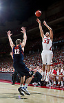 Wisconsin Badgers forward Rob Wilson (33) shoots a 3-pointer during a Big Ten Conference NCAA college basketball game against the Illinois Fighting Illini on Sunday, March 4, 2012 in Madison, Wisconsin. The Badgers won 70-56. (Photo by David Stluka)