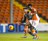 Blackpool's Armand Gnanduillet battles with Wycombe Wanderers' Joe Jacobson<br /> <br /> Photographer Alex Dodd/CameraSport<br /> <br /> Checkatrade Trophy Round 3 Blackpool v Wycombe Wanderers - Tuesday 10th January 2017 - Bloomfield Road - Blackpool<br />  <br /> World Copyright &copy; 2017 CameraSport. All rights reserved. 43 Linden Ave. Countesthorpe. Leicester. England. LE8 5PG - Tel: +44 (0) 116 277 4147 - admin@camerasport.com - www.camerasport.com