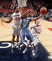 North Carolina forward James Michael McAdoo (43) is defended by Virginia guard Justin Anderson (23) during the game at the John Paul Jones arena in Charlottesville, Va. Virginia defeated North Carolina 61-52.