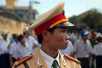 A Vietnamese police officer directs traffic in Hoi An, Vietnam..Kevin German / LUCEO