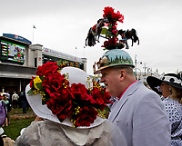 LOUISVILLE, KY - MAY 06: A man and women both wear fancy hats on Kentucky Derby Day at Churchill Downs on May 6, 2017 in Louisville, Kentucky. (Photo by Jesse Caris/Eclipse Sportswire/Getty Images)