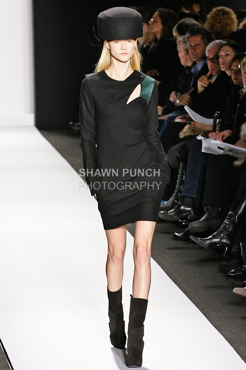 Kasia Struss walks the runway in a black wool/angoraflannel & emerald silk dress for the Narciso Rodriguez Fall/Winter 2010 fashion show, during Mercedes-Benz Fashion Week Fall 2010.
