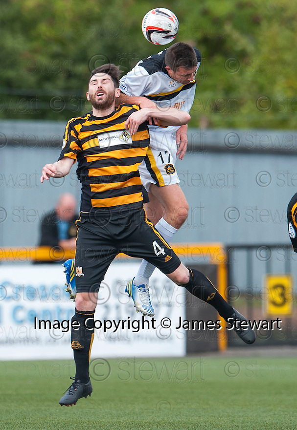 Dumbarton's Colin Nish gets above Alloa's Ben Gordon.
