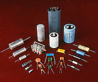 CAPACITORS<br /> Top to Bottom: AC - High capacity/High voltage - variable - ceramic dielectric &amp; Flanked on both sides by Electrolytic.