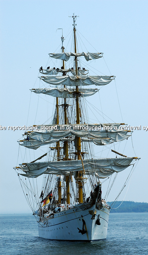 Tall Ship Furling sails in Halifax Harbor