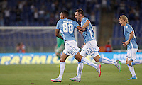 Calcio, Serie A: Lazio vs Bologna. Roma, stadio Olimpico, 22 agosto 2015.<br /> Lazio&rsquo;s Ricardo Kishna, left, celebrates with teammates Stefan De Vrij, center, and Dusan Basta after scoring during the Italian Serie A football match between Lazio and Bologna at Rome's Olympic stadium, 22 August 2015.<br /> UPDATE IMAGES PRESS/Isabella Bonotto