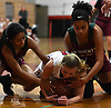 Alexa Marigliano #11 of Plainedge, center, tries to maintain possession as Brianna Guillen #15, left, and Aliyah Stone #13 of Glen Cove try to pry the ball from her during a Nassau AA-3 girls basketball game at Plainedge High School on Thursday, Dec. 20, 2018.