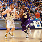 SIOUX FALLS, SD - MARCH 9:  Garret Covington #31 from Western Illinois drives against Zach Horstman #24 from South Dakota State University in the second half of their quarterfinal game at the 2014 Summit League Tournament Sunday evening in Sioux Falls, SD. (Photo by Dave Eggen/Inertia)
