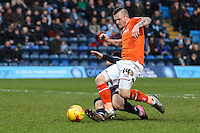 Joe Jacobson of Wycombe Wanderers challenges Jack Marriott of Luton Town (right) when he's through on goal during the Sky Bet League 2 match between Wycombe Wanderers and Luton Town at Adams Park, High Wycombe, England on 6 February 2016. Photo by David Horn.