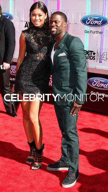LOS ANGELES, CA, USA - JUNE 29: Kevin Hart (R) and Eniko Parrish (L) arrive at the 2014 BET Awards held at Nokia Theatre L.A. Live on June 29, 2014 in Los Angeles, California, United States. (Photo by Xavier Collin/Celebrity Monitor)