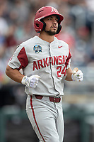 Arkansas Razorbacks outfielder Dominic Fletcher (24) runs to first base during Game 5 of the NCAA College World Series against the Texas Tech Red Raiders on June 17, 2019 at TD Ameritrade Park in Omaha, Nebraska. Texas Tech defeated Arkansas 5-4. (Andrew Woolley/Four Seam Images)