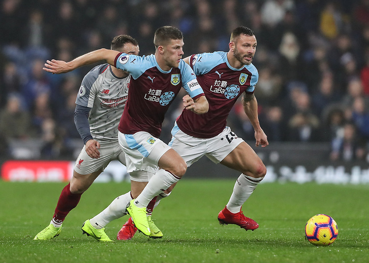Burnley's Johann Guomundsson breaks with Phillip Bardsley in support <br /> <br /> Photographer Andrew Kearns/CameraSport<br /> <br /> The Premier League - Burnley v Liverpool - Wednesday 5th December 2018 - Turf Moor - Burnley<br /> <br /> World Copyright &copy; 2018 CameraSport. All rights reserved. 43 Linden Ave. Countesthorpe. Leicester. England. LE8 5PG - Tel: +44 (0) 116 277 4147 - admin@camerasport.com - www.camerasport.com