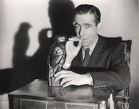 BNPS.co.uk (01202) 558833<br /> Picture: WarnerBrothers<br /> <br /> Million Dollar prop...<br /> <br /> A lead statue of a bird which turned out to be a worthless dud in the Hollywood film The Maltese Falcon has sold for a whopping &pound;2.5 million.<br /> <br /> The 12-inch falcon was the object of desire of Humphrey Bogart's private detective character, who wrongly believed it to be a priceless, jewel-encrusted gold antique.<br /> <br /> Experts had expected it to sell for &pound;1 million but it was snapped up by an anonymous bidder for &pound;2.5 million at the Bonhams sale in New York.