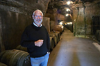 Oak barrel aging and fermentation cellar. Noel Pinguet, winemaker, owner. Domaine Huet, Vouvray, Touraine, Loire, France