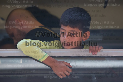 Illegal migrant boy looks out of the window of a train as his family tries to leave for Germany at the main railway station Keleti in Budapest, Hungary on September 03, 2015. ATTILA VOLGYI