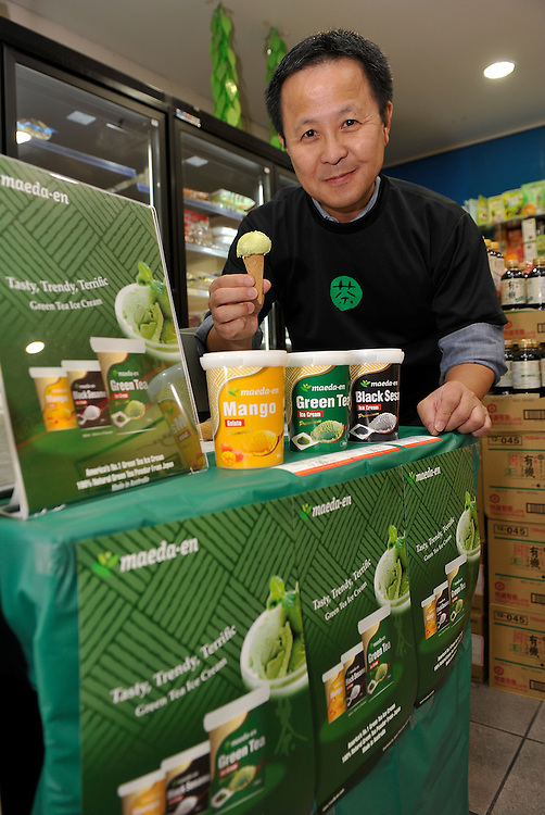 Maeda-en CEO and CQO Taku H. Maeda, poses with a sample cone of green tea ice cream during the launch of Maeda-en's range of green tea and black sesame ice cream and mango sorbet at Formosa Asian Market, Sunnybank, , Brisbane, Queensland, Saturday, October 01, 2011. (Photo by John Pryke/JKDImagery)