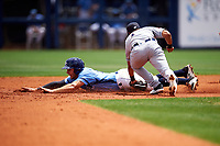 Charlotte Stone Crabs third baseman Kevin Padlo (11) puts a tag on a runner during a game against the Lakeland Flying Tigers on April 16, 2017 at Charlotte Sports Park in Port Charlotte, Florida.  Lakeland defeated Charlotte 4-2.  (Mike Janes/Four Seam Images)