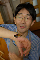 "Shoichi Uchiyama showing off one of the Madagascar cockroaches he keeps at home.Tokyo resident Shoichi Uchiyama is the author of ""Fun Insect Cooking"". His blog on the topic gets 400 hits a day. He believes insects could one day be the solution to food shortages, and that rearing bugs at home could dispel food safety worries."