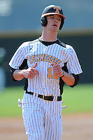 Charley Thurber #12 of the Tennessee Volunteers runs to third at Lindsey Nelson Stadium against the the Manhattan Jaspers on March 12, 2011 in Knoxville, Tennessee.  Tennessee won the first game of the double header 11-5.  Photo by Tony Farlow / Four Seam Images..