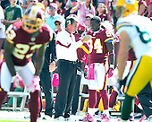 Washington Redskins head coach Mike Shanahan, left, discusses strategy with wide receiver Joey Galloway (84), right, during first half action against the Green Bay Packers at FedEx Field in Landover, Maryland on Sunday, October 10, 2010..Credit: Ron Sachs / CNP