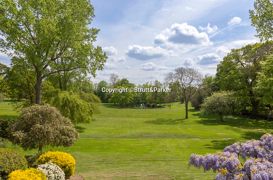 BNPS.co.uk (01202 558833)<br /> Pic:  Strutt&Parker/BNPS<br /> <br /> An elegant Georgian villa which featured prominently in the classic film Blithe Spirit has emerged on the market for £6.5million.<br /> <br /> Grade II listed Denham Mount, in Denham, Middlesex, was used for the 1945 film adaptation of Noel Coward's comic play starring Rex Harrison and Constance Cummings.<br /> <br /> Much of the film was shot in the property's veranda which overlooks picturesque parkland and a lake.<br /> <br /> The villa was built by architect Robert Lugar in the early 19th century who said of it 'this pleasing retreat offers everything the mind of taste could require to produce comfort and cheerfulness'.