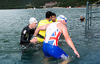 09 SEP 2011 - BEIJING, CHN - Liam Gentry (right) guides TRI-6 competitor Iain Dawson (GBR) from the water at the end of the swim during the 2011 ITU World Paratriathlon Championships .(PHOTO (C) NIGEL FARROW)