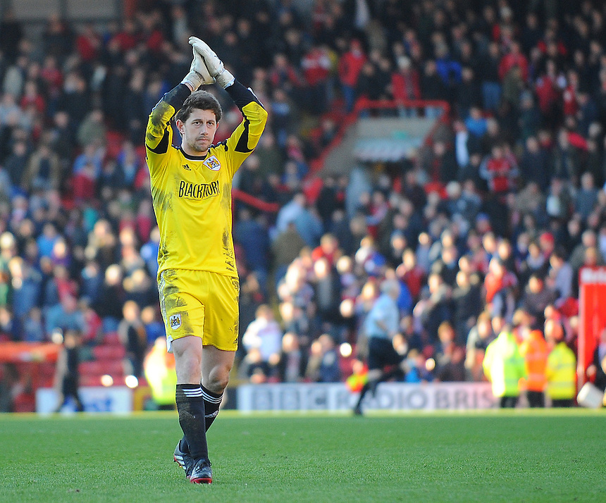 Bristol City's Frank Fielding applauds home supporters at the final whistle<br /> <br /> Photo by Kevin Barnes/CameraSport<br /> <br /> Football - The Football League Sky Bet League One - Bristol City v Swindon Town - Saturday 15th March 2014 - Ashton Gate - Bristol<br /> <br /> &copy; CameraSport - 43 Linden Ave. Countesthorpe. Leicester. England. LE8 5PG - Tel: +44 (0) 116 277 4147 - admin@camerasport.com - www.camerasport.com