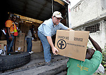 In Port-au-Prince, Don Tatlock (center), an emergency worker for Church World Service, a member of the ACT Alliance, unloads tons of relief material brought into earthquake-ravaged Haiti from the Dominican Republic on January 25.
