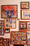 A wall of photos of children and grandchildren inside of Jeannie and Larry Klein's home in Sun City, Arizona.