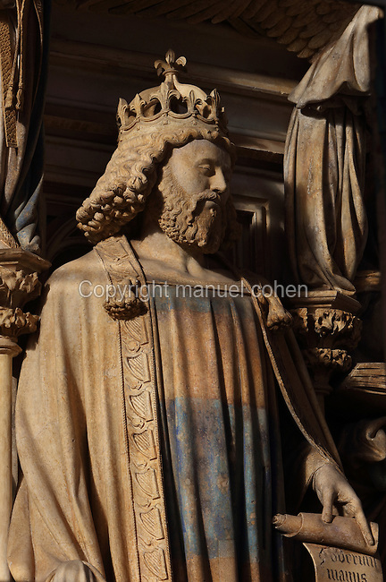 King David, wearing a crown and holding a psalm, from the Puits de Moise, or Well of Moses, 1395-1403, sculpted by Claus Sluter, 1340-1406, and his studio, and painted by Jean Malouel, 1365-1415, in the courtyard of the Chartreuse de Champmol, the burial site of Philippe le Hardi duc de Bourgogne, or Philip the Bold Duke of Burgundy, now the Hospital de la Chartreuse, Dijon, Burgundy, France. The sculpture was commissioned by Jean sans Peur or John the Fearless, and consists of a crucifixion scene surrounded by 6 prophets (Moses, David, Jeremiah, Zachariah, Daniel and Isaiah), with 6 weeping angels. The hexagonal building surrounding the sculpture was added in the 17th century. Picture by Manuel Cohen