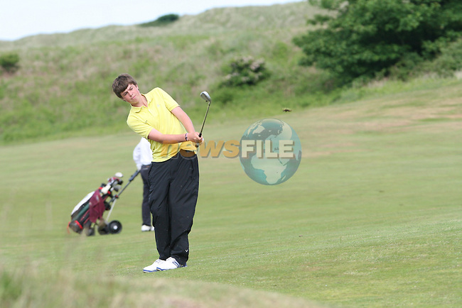 Conor Glynn of Carton House Golf Club hitting onto the 3rd green on day 2 of the 2010 East of Ireland Amateur Golf Competition in Co.Louth Golf Club...Photo NEWSFILE/Jenny Matthews.(Photo credit should read Jenny Matthews/NEWSFILE)....This Picture has been sent you under the condtions enclosed by:.Newsfile Ltd..The Studio,.Millmount Abbey,.Drogheda,.Co Meath..Ireland..Tel: +353(0)41-9871240.Fax: +353(0)41-9871260.GSM: +353(0)86-2500958.email: pictures@newsfile.ie.www.newsfile.ie.FTP: 193.120.102.198.