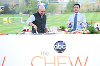 "October  14, 2011 - Bristol, CT - Campus Green: ABC's ""The Chew"" Chef Michael Symon with NASCAR Now's Michael Yam...Credit: Joe Faraoni"