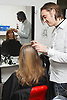 Hairdresser who has Ehlers-Danlos Syndrome (EDS), helped into employment by the Ready 4 Work team, Nottinghamshire County Council, colouring a woman's hair