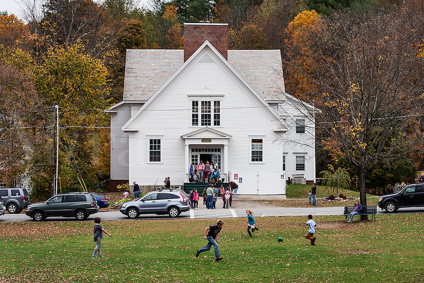 School letting out at an old fashioned school house, Towhend, Vermont, USA