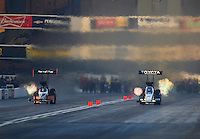 Feb 12, 2016; Pomona, CA, USA; NHRA top fuel driver Clay Millican (left) races alongside Steve Torrence during qualifying for the Winternationals at Auto Club Raceway at Pomona. Mandatory Credit: Mark J. Rebilas-USA TODAY Sports