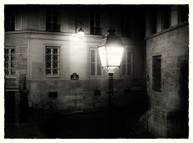 Paris back street at night with street light
