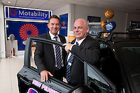 Andy Moss, General Manager of Bristol Street Motors Peugot with Motability Speacialist Gary Lloyd (right)