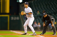 First baseman J.T. Chargois #14 of the Rice Owls on defense against the Kentucky Wildcats at Minute Maid Park on March 4, 2011 in Houston, Texas.  Photo by Brian Westerholt / Four Seam Images