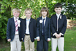 John O'Connell, Niall McGinnity, Cathal Quinn and David Lally at First Communion in Sandpit Church on Saturday.