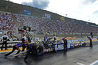 Jul, 20, 2012; Morrison, CO, USA: NHRA crew members for top fuel dragster driver Antron Brown during qualifying for the Mile High Nationals at Bandimere Speedway. Mandatory Credit: Mark J. Rebilas-